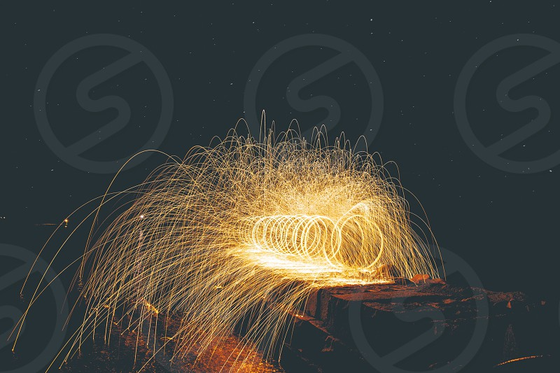 time lapse of firecracker building round light photo