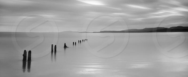 Blackandwhite black white b&w mono highkey ocean sea water beach cloud clouds sky Ireland Coast posts mountains landscape Kerry high key reflections silhouetted silhouette calm longexposure canon  photo