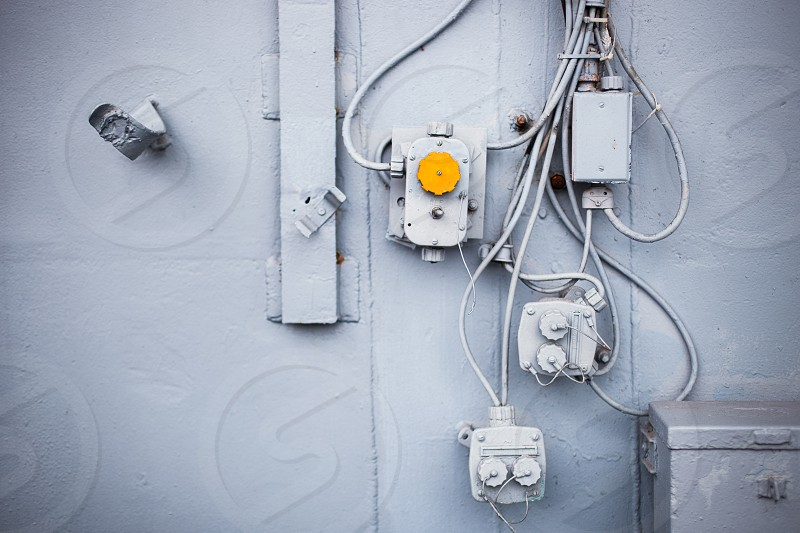 Abstract detail closeup blue yellow ship naval military industrial conduit dials controls geometric photo