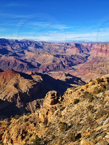 View of the Grand Canyon the Colorado River winds its way into the distance photo