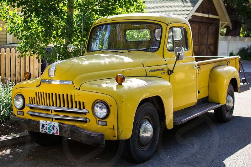 yellow vintage step side pick up truck photo