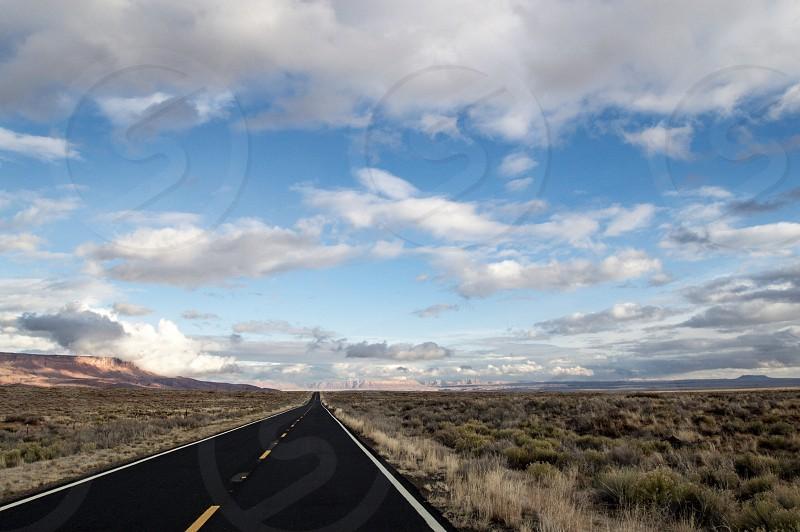 Road trip open road sky clouds blue landscape  photo