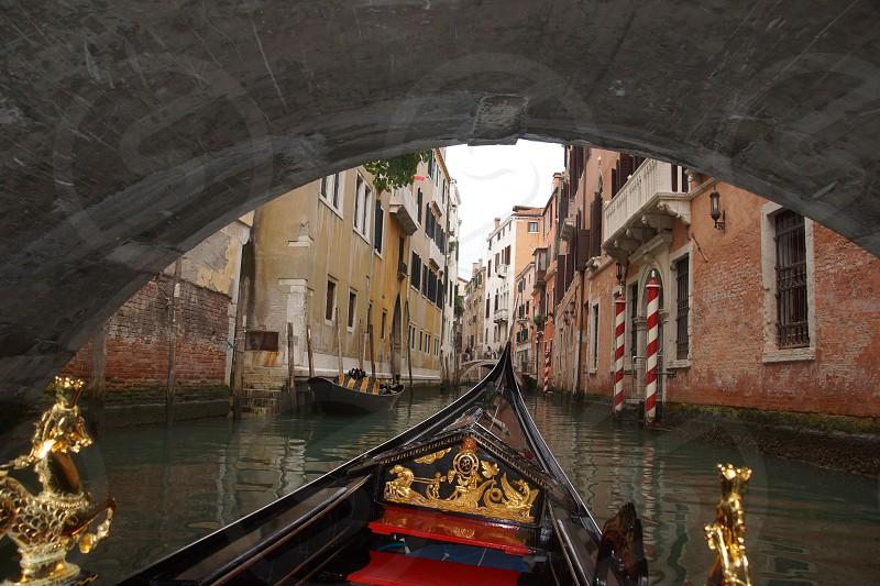 boat passing underneath bridge photo