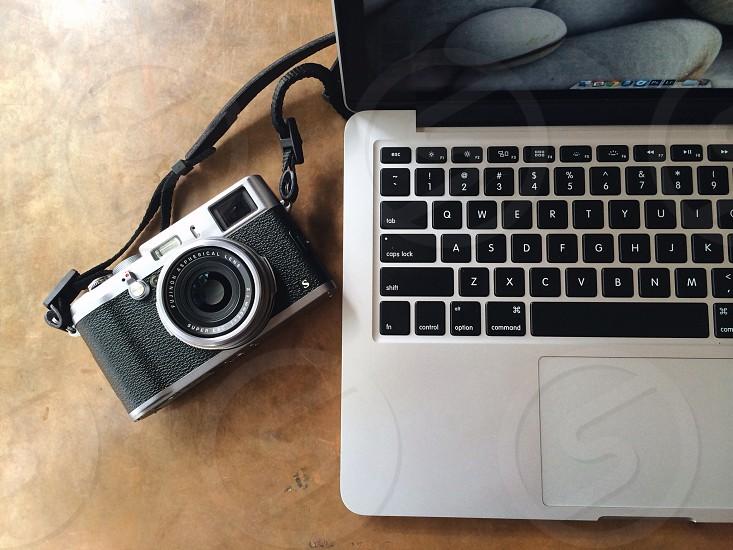 apple macbook pro beside grey and black digital camera photo