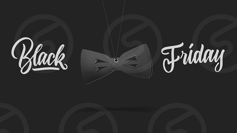 label in shape bow tie on high hill made of cardboard on a gray background.a Calligraphic text black Friday and sales luxury premium style concept photo