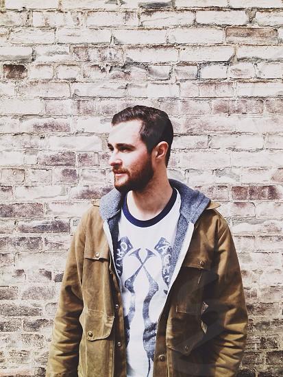 men's brown jacket photo
