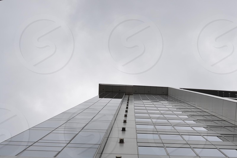 low angle photography of high rise building under gray cloudy sky during daytime photo
