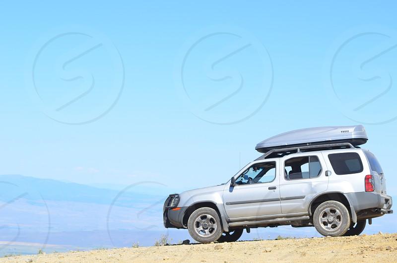 Nissan Xterra travel carrier road trip vehicle photo