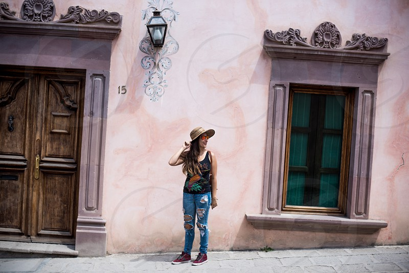 Female traveler in an old Mexican village  photo