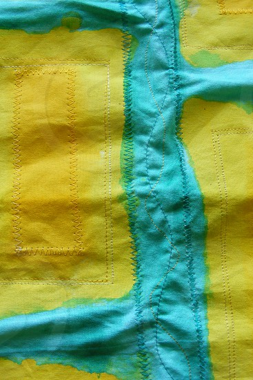 Teal and Yellow hand painted fabric using fabric paint and inktense. Free stitched. Textile design photo