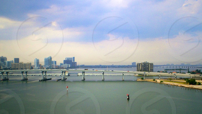 city with high rise building with grey concrete bridge photo