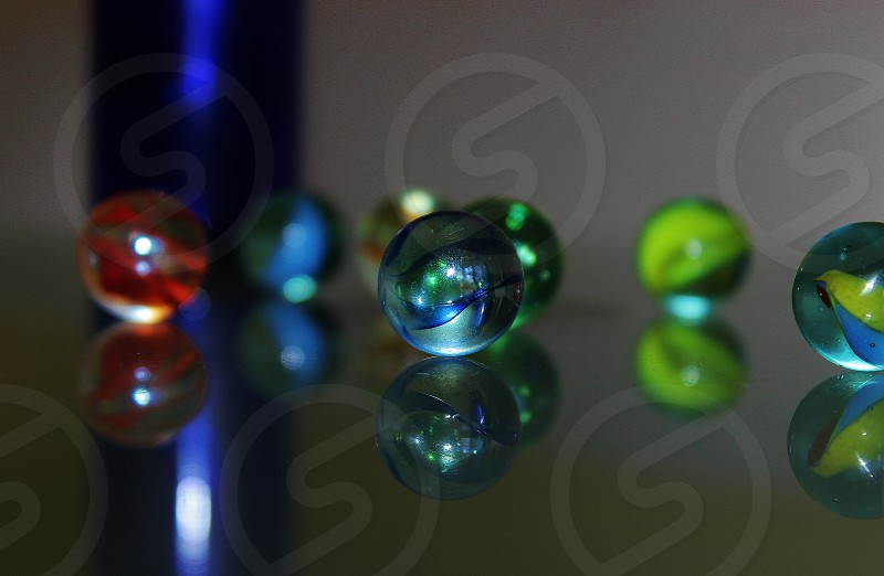marbles on a glass table photo