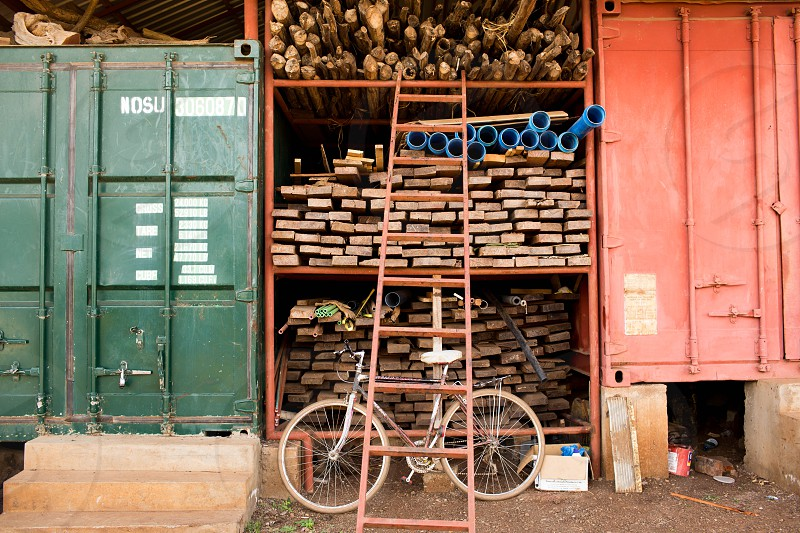 red step ladder in front of silver hard tail bicycle photo