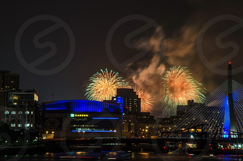 lighted buildings suspension bridge blue light fireworks photo