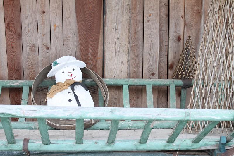snowman decor on bench photo