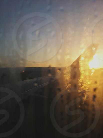 airplane terminal gate waiting sunrise window. photo