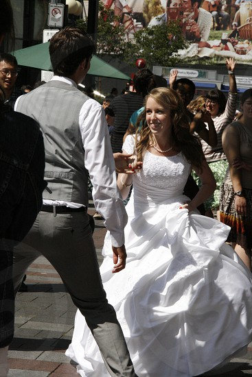 Bride and groom dancing in the park. Seattle WA.  photo