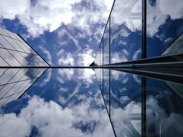 clouds vs glass. architectural reflections. photo