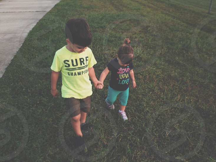 My son and daughter talking a walk  photo