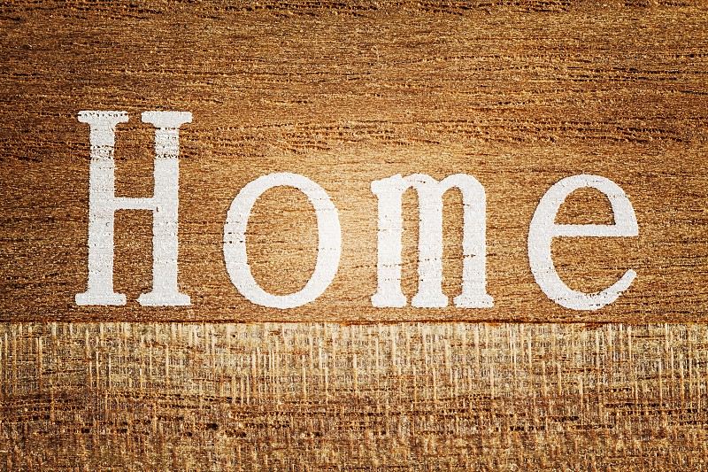 Word Home printed on a wooden plank.  photo