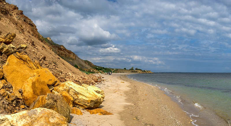 Natural Shell rocks and stones  on the coast of Odessa in Ukraine on a sunny spring day photo