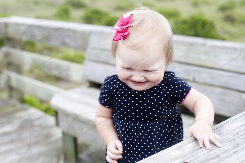 girl wearing black and white dress smiling during daytime photo