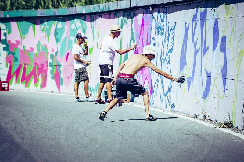 Imperia Italy - 08/09/2018: Wall of Imperia city centre Graffiti Artist Spray Painting Wall Art. photo