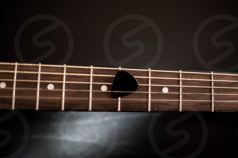 guitar neck and guitar pick photo