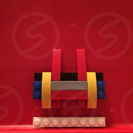 assorted-color interlocking toys on plastic top photo