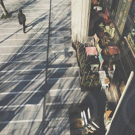man in black jeans walking photo