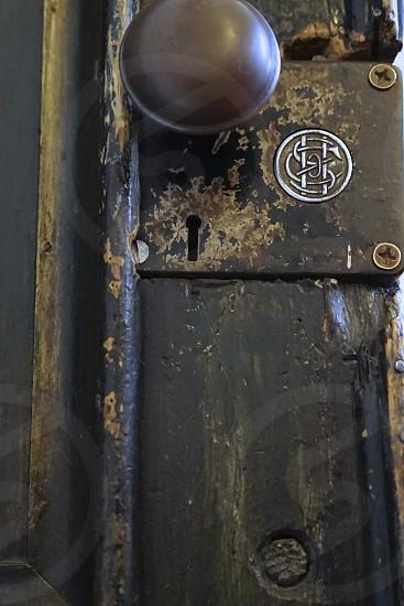 Doorknob and symbol on old door of church photo