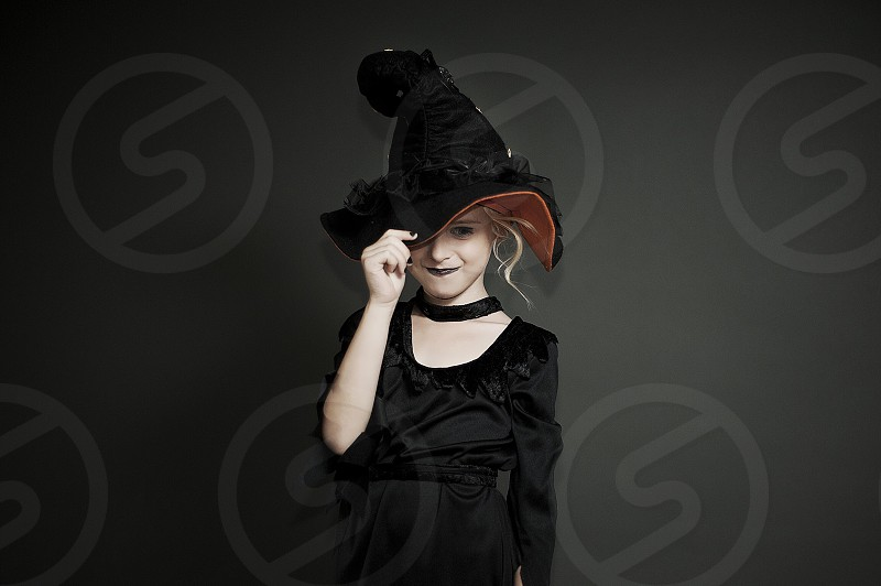 girl dressed in black outfit witch hat photo