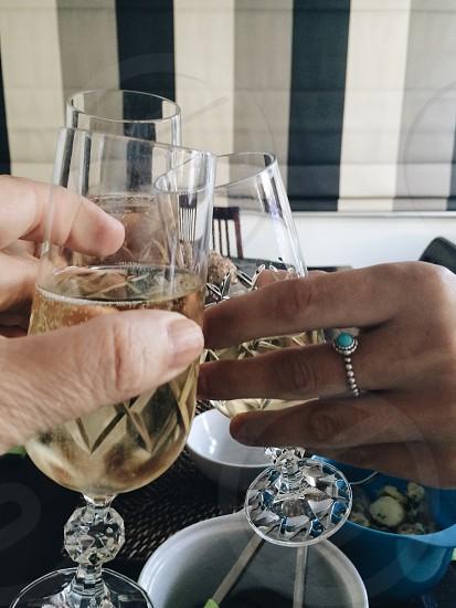 Champagne new year celebration pov glasses photo
