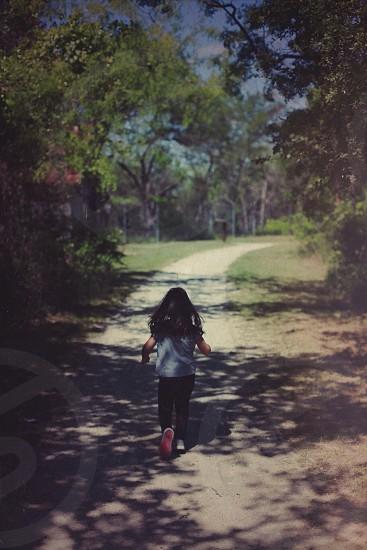girl in grey shirt running photo