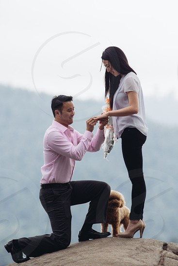 Engaged surprise engagement mountain top north Vancouver photo