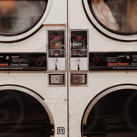 white and black front load washer photo
