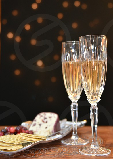 Sparkling wine cheese crackers cranberries  photo
