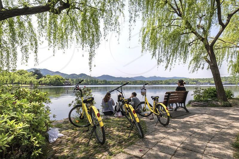 Asia china hangzhou west lake travel bycicle photo