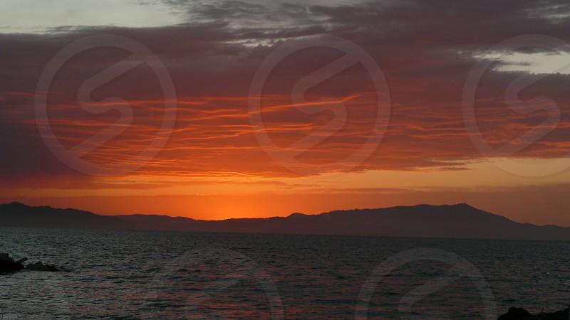 Orange Sunset with layered clouds photo