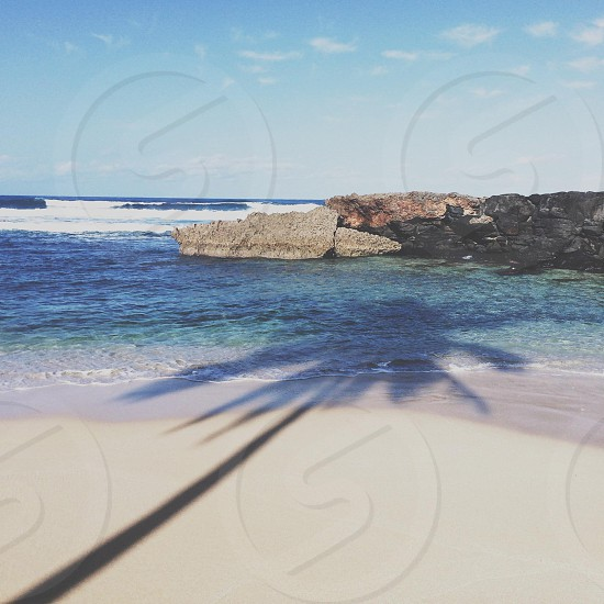 beach and blue ocean water photo