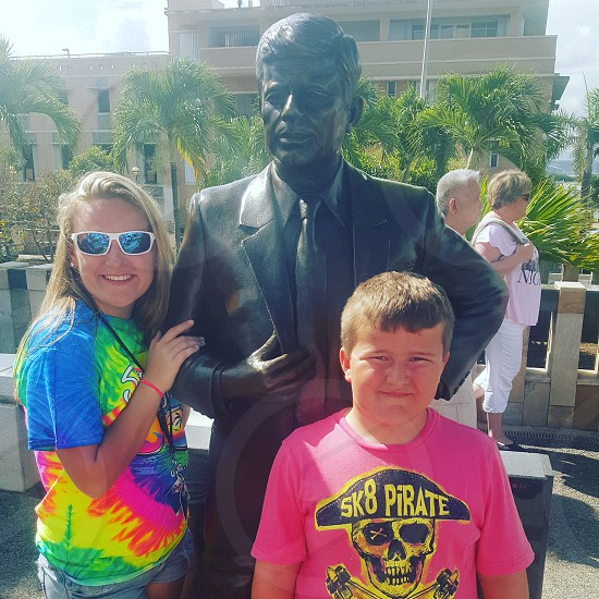 my kids in Puerto Rico with a statue of John F Kennedy photo