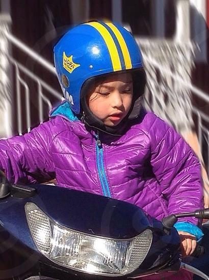 boy sitting on motorcycle photo