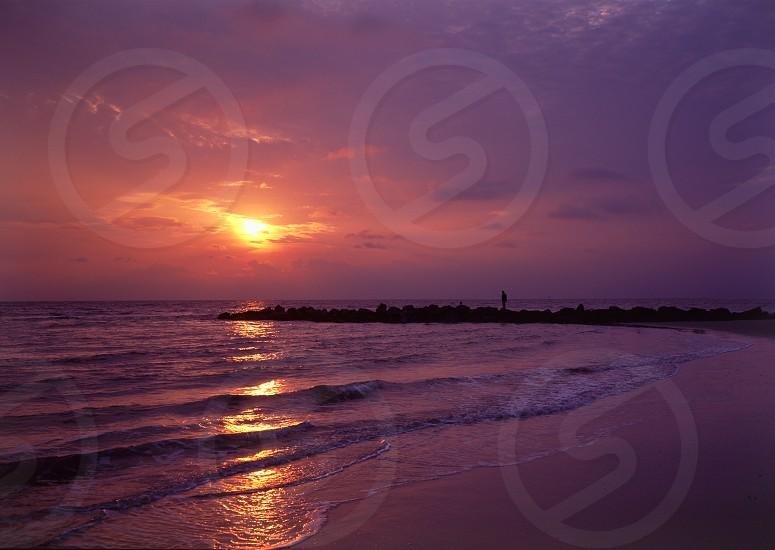 Fisherman on Beach at Dawn photo
