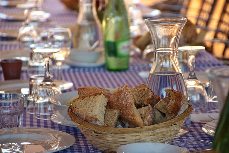 Rustic table prepared for dinner photo