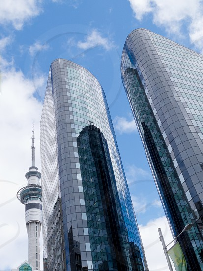 Auckland Sky Tower the tallest building of the Southern Hemisphere seen among office building high risers in Auckland New Zealand NZ photo
