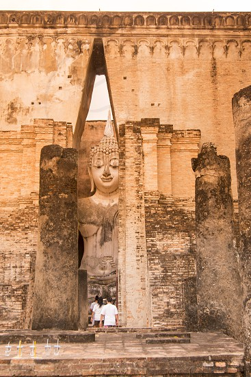 the Buddha at the Wat Si Chum at the Historical Park in Sukhothai in the Provinz Sukhothai in Thailand.   Thailand Sukhothai November 2018 photo