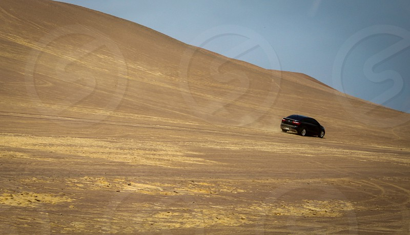 Desert car off-road driving Peru isolated independent  photo