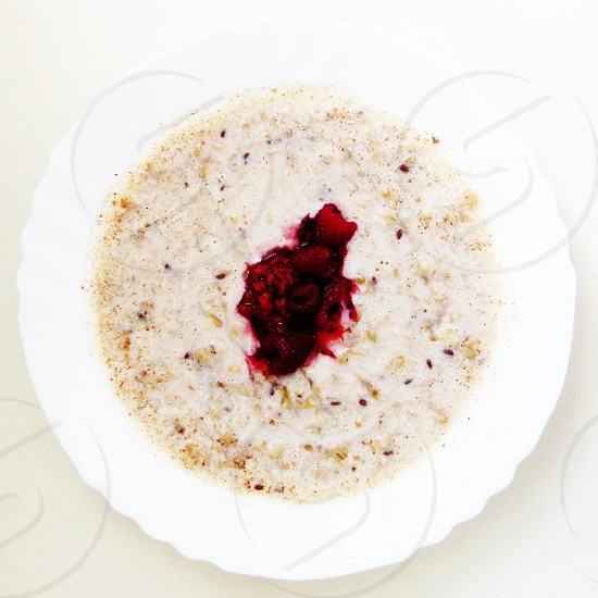 Breakfast oatmeal with raspberries. photo
