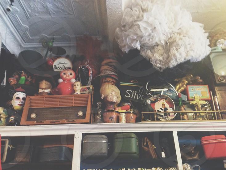 vintage shop dolls tutus creepy cool old trinket hats photo