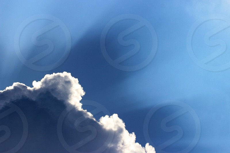 blue sky with comulonimbus clouds photo